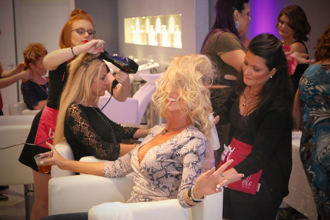 Amy Hairr (client) getting styled by Blo The Woodlands.