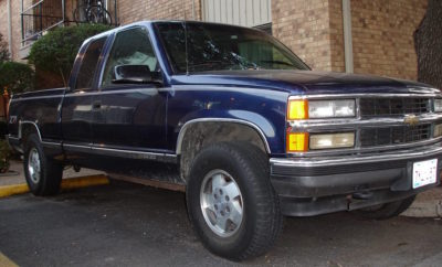 1995 blue Chevy Silverado bearing TX license plate #9351AG that was stolen from a home vehicle repair shop in Conroe Texas