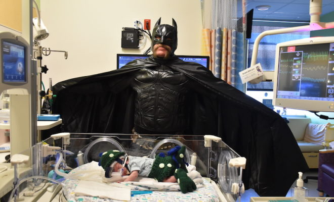 """Babies in the level III Neonatal Intensive Care Unit at Texas Children's Hospital The Woodlands got a surprise Halloween visit from """"Batman"""" yesterday."""