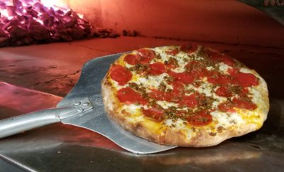 Pepperoni and Italian Sausage Pizza coming out of the Coal Fired Oven. Photo by Nick Rama.