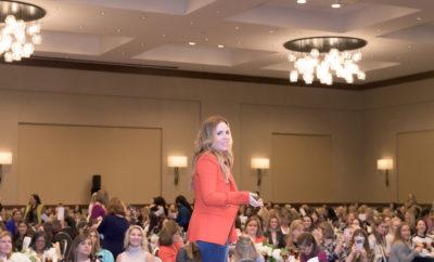 Photo 2 Cutline:Rachel Hollis speaks to 730 guests at Women Empowering Women (Photo Courtesy Derrick Bryant)