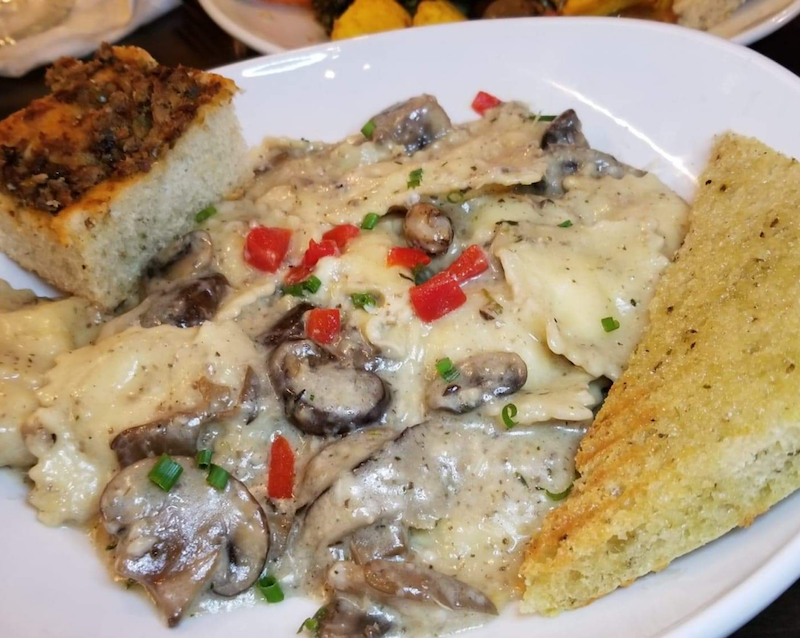 Cheese Ravioli - House made four cheese ravioli, creamy mushroom sauce, mushroom medley, parmesan, white truffle oil. Photo by Nick Rama