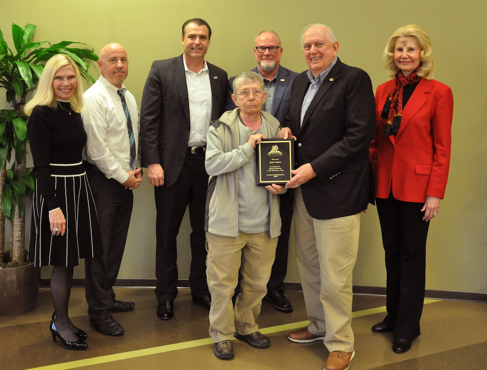 The Woodlands Township honored Mary Sydow, Volunteer of the Year for Covenant Administration. Pictured left to right: Secretary Dr. Ann K. Snyder, Treasurer John Anthony Brown, Chairman Gordy Bunch, Mary Sydow, Director Bob Milner, Vice Chairman Bruce Rieser and Director Dr. Shelley Sekula-Gibbs.