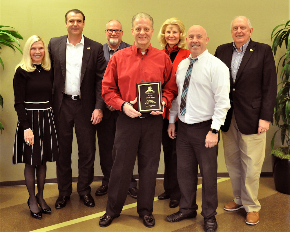 The Woodlands Township honored Michael Bisbee, Volunteer of the Year for Parks and Recreation. Pictured left to right: Secretary Dr. Ann K. Snyder, Chairman Gordy Bunch, Director Bob Milner, Michael Bisbee, Director Dr. Shelley Sekula-Gibbs, Treasurer John Anthony Brown and Vice Chairman Bruce Rieser.