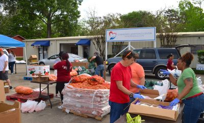 COMMUNITY ASSISTANCE CENTER SERVES NEIGHBORS IN NEED WITH DRIVE THRU GROCERIES